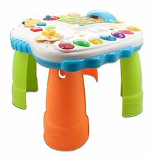 Childrens work and play table with phone for toddlers learning to stand interact