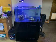 125 gallon custom fish tank. Includes stand, plumbing and lots of gear.
