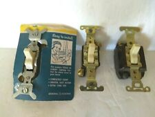 Vintage General Electric GE Silent Light Switch and 2 LEVITON switches.