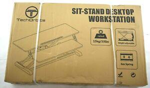TechOrbits Adjustable Height Black Adjustable Height Sit Stand Desktop Station