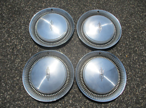 Genuine 1974 to 1976 Oldsmobile Delta 88 15 inch hubcaps wheel covers