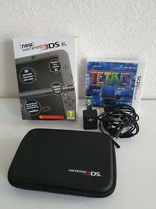 Console New 3ds xl Noir neuve jamais servi + housse + chargeur + jeu tetris neuf