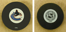 LOT OF 2 HOCKEY PUCKS -NHL OFFICIAL IN GLAS CO - VANCOUVER CANUCKS  - FREE SHIP