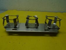 3 Flask Clamps for Shaker Table Mounted on a Stainless Plate Used