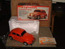 VINTAGE NOS MUSICAL VOLKSWAGEN IN RED W/BUMP'N GO, LIGHTS, MUSIC AND MORE W/BOX!