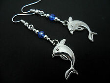 A PAIR OF TIBETAN SILVER  BLUE CRYSTAL DANGLY DOLPHIN THEMED EARRINGS. NEW.