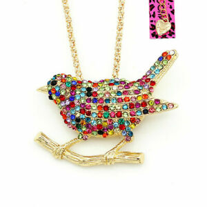BETSEY JOHNSON'S GOLD PLATED MULTI CRYSTAL SAPPHIRE BIRD PENDANT OR BROACH