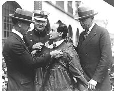 Photo of Harry Houdini Placed in a Straightjacket being Secured by Strangers