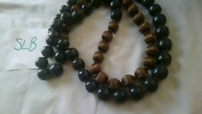 Hultquist necklace two tone green plastic and bronze tone textured metal