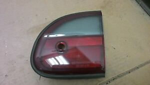 1997 - 1999 Chevrolet Malibu  RH trunk mounted tail light with keyhole  OEM