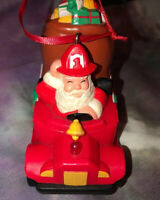 Vintage Avon Santa Claus Driving A Fire Truck Christmas Ornament Lights Up