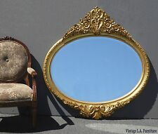French Provincial Rococo Style Ornately Carved Gold Oval Wall Mantle Mirror
