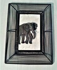 elephant wall deco, metal and tile
