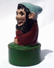 2 of 3 folky concrete garden gnomes.: has blue hat and a base made from a can.