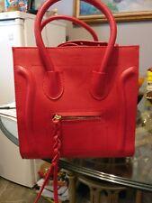 Used red genuine leather handbag