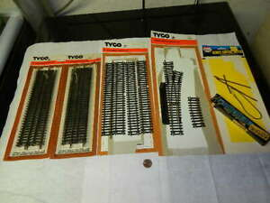 Lot of Tyco HO brass rail track with original packages, older likely from 1970's