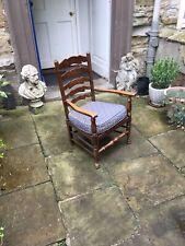 Early twentieth century oak finished low ladder back armchair