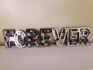 Mosaic Forever Sign - Colourful mirror pieces spell the word FOREVER