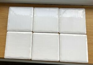 Pilkingtons small white wall tiles size 10cm x 10cm square. Coverage for 10 sq m