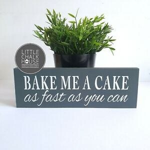 Bake me a cake as fast as you can, standing sign