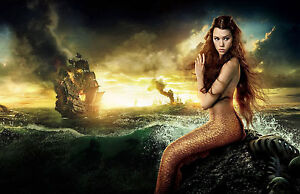 Framed Print - Mermaid Sitting on the Rocks as Pirate Ships Burn (Picture Art)