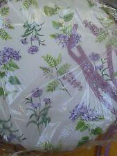 cuscini per sedie Rotondi fondo beige condisegbo lavanda in lilla