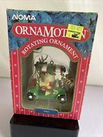"Vintage 1989 Noma Ornamotion Rotating Ornament ""Fore"" Golf Cart Santa Reindeer"