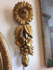 décoration en bois doré 18ème siècle à décor de fleurs