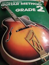Mel Bay's Modern Guitar Method, Grade 1 and two. Sold as set. Over 7 million pri