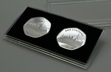 Pair of RMS Titanic and Lusitania Silver Commemoratives & 50p Coin Display Case