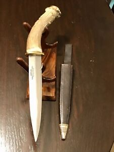 vintage fixed blade knife. Crown Stag antler, Korium Solingen Dagger And Sheath.