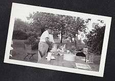 Antique Photograph Two Men & Little Girl Sitting At Picnic Table in Backyard