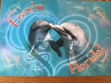Postcard New & Unused Florida- Love'N Florida With 2 Dolphins On Front.