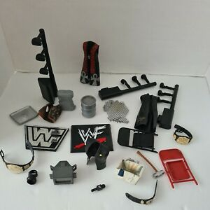 Large Bundle Of Wwe Accessories Belts Weapons Jackets Microphone