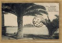 Cpa Antibes - le fort carré et anse de St Roch vus à travers les palmiers rp013