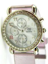 CG Wrist ladies Watch Silver Ton crystals at bezel/decorative 3 eye/new battery