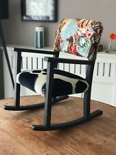 Vintage reupholstered child's rocking chair featuring charras/cowgirl fabric
