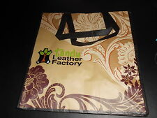 (1) Large Plastic Tandy Tote Bag with Handles.