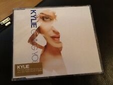 KYLIE MINOGUE . GIVING YOU UP / MADE OF GLASS  . C.D. SINGLE . MINT NEW