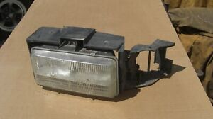 1994-1996 Cadillac Fleetwood Headlight Assembly LH OEM used