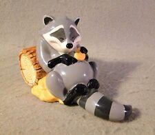 Disney's Pocahontas Ceramic Meeko Racoon with biscuits on log Figurine By Enesco