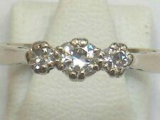 18CT WHITE GOLD 1/4 CARAT DIAMOND TRILOGY RING. SIZE L 1/2. FULL HALLMARKS A4180