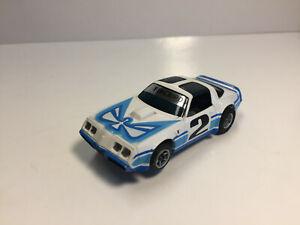 AFX FIREBIRD with Headlights  White/Blue #2  Brand New  Model Motoring Aurora HO