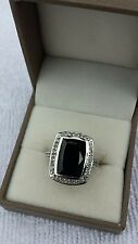 Black spinel and white topaz sterling silver ring
