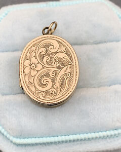 Vintage 9ct gold floral swirl oval locket pendant.