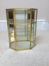 Small glass/brass display cabinet with mirror backing and two shelves