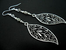A PAIR OF TIBETAN SILVER LONG LEAF THEMED EARRINGS. NEW.