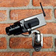 CCTV WIRELESS MOTION SENSOR DUMMY SECURITY CAMERA PANNING MOVEMENT LED LIGHT