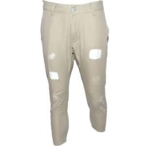 Pantaloni jogger neri beige con bottone e tasche laterali con strappi e toppe ca