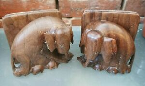 VINTAGE PAIR OF HARD WOOD ELEPHANT HEAD BOOK ENDS WITH DAMAGED EARS